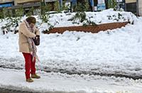 Madrid, Spain. 10 th January 2021. View of a woman in San Bernardo street after the storm snow. Credit: Enrique Davó.