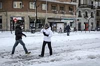 Madrid, Spain. 10 th January 2021. View of a walkers in Fuencarral street after storm snow. Credit: Enrique Davó.