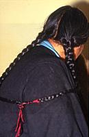 Tibetan with this peculiarity, a hairstyle of Plaits, Mac leod Ganj, HP, India.
