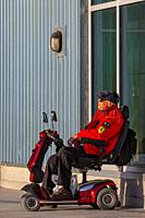 Older gentleman relaxing in December sunshine along the Steveston waterfront in British Columbia Canada.