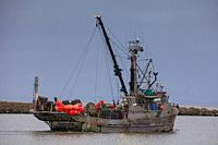 Commercial fishing vessel Pacific Viking heading out from Steveston Harbour to lay Crab Pots British Columbia Canada.