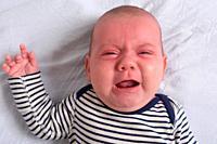 portrait of a baby reddish skin cry.