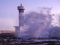 strong waves on the Puntassa lighthouse in Colònia de Sant Jordi, ses Salines, Mallorca, Balearic Islands, Spain.