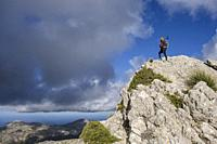 lonely woman on the ridge, ascending to Serra Des Teixos, Escorca, Mallorca, Balearic Islands, Spain.