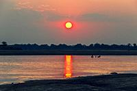 Sunsetting by river in South Luangwa National Park, Zambia, Africa.