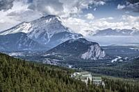 View from Sulphur Mountain of the town of Banff and its surroundings area with Cascade Mountain towering above in the distance. Banff National Park, R...