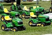 Display of John Deer lawn and garden tractors.