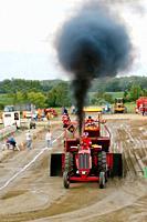 Farmer participates in a tractor pull contest.