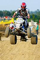 ATV All Terrain Vechiles participate in off road motocross type of race.