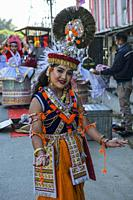 Imphal, India - December 2020: A traditional Manipurian dance dancer on a street in Imphal on December 27, 2020 in Manipur, India.