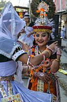 Imphal, India - December 2020: Traditional dancers taking a selfie on a street in Imphal on December 27, 2020 in Manipur, India.
