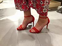 red shoes of a young woman in shopping mall from low angle.