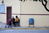 Two women sitting on a bench in Candeleda, Ã. vila.