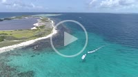 Caribbean-sea-Fantastic-landscape Kitesuf in clear crystal water, from drone in Los Roques venezuela -