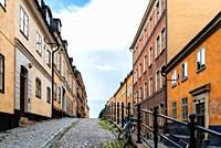 Picturesque cobblestoned street with colorful houses in Ugglan quarter in Sodermalm in Stockholm.