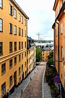 Picturesque street with colorful houses in Ugglan quarter in Sodermalm, Stockholm, Sweden.