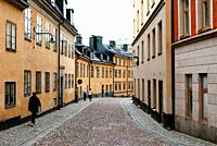 Picturesque cobblestoned street with colorful houses in Ugglan quarter in Sodermalm, Stockholm, Sweden.