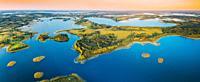 Braslaw Or Braslau, Vitebsk Voblast, Belarus. Aerial View Of Nedrava Lake And Green Forest Landscape In Sunny Summer Morning. Top View Of Beautiful Eu...