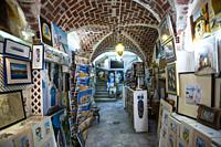 The stunning interior of a retail shop selling traditional arts and crafts. Walls are decorated with gorgeous tiles. Sidi Bou Said, Tunisia, Africa.