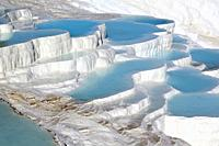 Pamukkale, Denizli Province, Turkey. The white travertine limestone terraces and pools. Pamukkale is known as the Cotton Castle. It is a UNESCO World ...