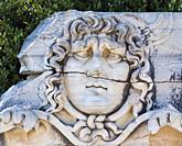 Ruins of ancient Didyma at Didim, Aydin Province, Turkey. Carved relief of the head of Medusa.