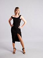 Young and pretty woman poses in short black dress on gray background.