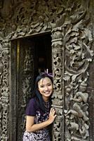 Myanmar, Mandalay, Pretty girl posing before Shwenandaw monastery (19th C).
