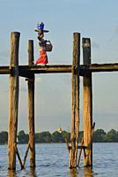 Myanmar, Amarapura, U Bein bridge and Taungthaman lake at sunset.