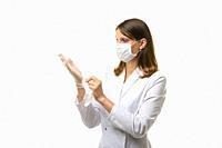 Girl doctor puts on transparent medical gloves on her hands.