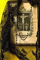 Christ, rosary and black veil.