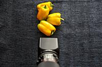 Yellow peppers and a Hasselblad 503 CW camera.
