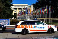 police car in front of Palace of Nations in Geneva, Switzerland, Europe