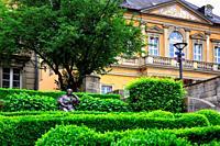 Margravine Wilhelmine, Wilhelmine von Bayreuth sculpture, Schlossterrassen park, in background rectory, vicarage and nursery school buildings belongin...