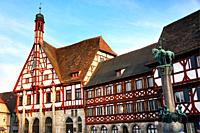 Half-timbered buildings at Rathausplatz - Town hall square, on left - Rathaus - Town Hall, on right Kriegerbrunnen - Warrior fountain, historic part o...