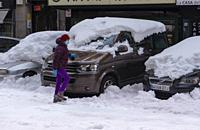 Madrid, Spain. 10 th January 2021. View of a car in San Bernardo street, Chamberi quarter, after Filomena snow storm.