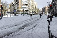 Madrid, Spain. 10 th January 2021. View of walkers in San Bernardo street, Chamberi quarter, after Filomena snow storm.