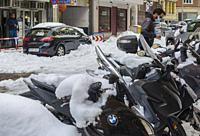 Madrid, Spain. 10 th January 2021. View of motorcycles in San Bernardo street, Chamberi quarter, after Filomena snow storm.