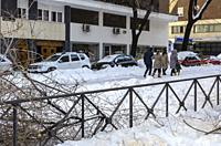 Madrid, Spain. 10 th January 2021. View of a walkers in Rodríguez San Pedro street, Chamberi quarter, after Filomena snow storm.