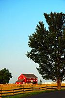 A small red barn on the historic John Sherfy farm still stands in Gettysburg National Historic Battlefield.