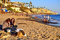 Two women relax on the sunny shores of Laguna Beach, California.