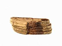 stack of sliced rye flour bread isolated on white background, close up.