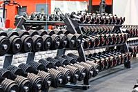 Rows of metal dumbbells on rack in the gym. Weight Training Equipment.