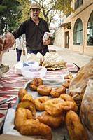 sale of donuts, weekly market, Sineu, Mallorca, Balearic Islands, Spain.