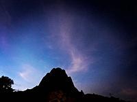 The Peña de Bernal monolite rock mountain at night in San Sebastian Bernal, Mexico