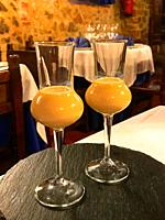 Two glasses of liqueur in a restaurant. Spain.