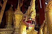 Head of a Naga serpent of the golden Royal funeral carriage, Royal Funerary Carriage house, Temple Wat Xieng Thong, Luang Prabang, Laos.