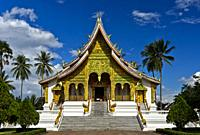 Intricately adorned facade of the Haw Pha Bang temple on the ground of the former Royal Palace, Luang Prabang, Laos.
