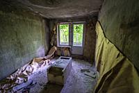 Room in abandoned block of flats in Chernobyl-2 military base, Chernobyl Nuclear Power Plant Zone of Alienation in Ukraine.