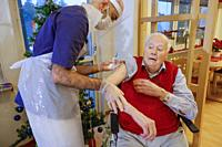 Stockholm, Sweden A senior man gets a Pfizer-BioNTech Covid-19 vaccine in a senior home from a male nurse.