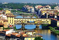 Florence, Florence Province, Tuscany, Italy. View from Piazzale Michelangelo for historic part and bridges across Arno river. Ponte Vecchio in foregro...